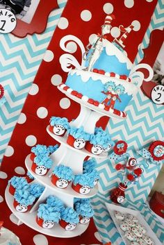 Cake at a Dr. Seuss Party....this would be a cute baby shower theme...have everyone bring a Dr. Seuss book to start baby off right(-: