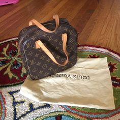 LAST PRICE DROP Authentic Louis Vuitton Purse Spontini AUTHENTIC LV Reposting this bag is in brand new condition, except for pen stains on inside and possible reddish pink lipstick stain on inside of one pocket. Otherwise immaculate everywhere else. PRICED ACCORDINGLY Louis Vuitton Bags Mini Bags