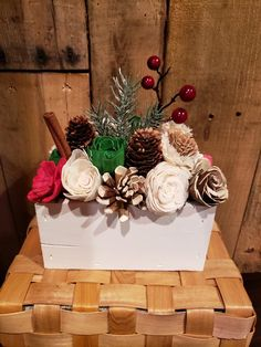 Christmas wood centerpiece.  Wood flowers, pine cones, cinnamon stick, greenery, pics.  Farmhouse, rustic, holiday.  Mantle table countertop