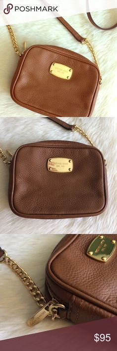 """❌FINAL PRICE❌Michael Kors """"Jet Set"""" Mini Bag! Michael Kors """"Jet Set"""" Crossbody Mini Bag! EXCELLENT USED CONDITION! Used ONCE while on vacation + I haven't used it since! Luxurious gold tone hardware + chain detailing. 100% authentic. Tag reads AV-1504. The only flaw I can find is scratching on the underside of the zipper pull as shown in photo that cannot be seen when worn. 1 interior slip pocket along with 4 interior credit card pockets. Approx. measurements: 6"""" L x 4.5"""" W x 1.5"""" D. ❌No…"""