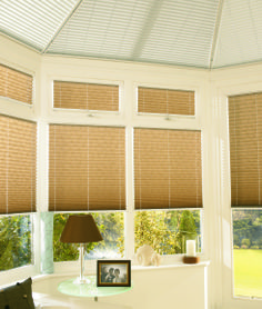 Soft neutral tones look welcoming in the conservatory. Please visit us at www.barnesblinds.co.uk