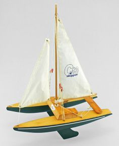 A wooden toy catamaran by Skipper Yachts.