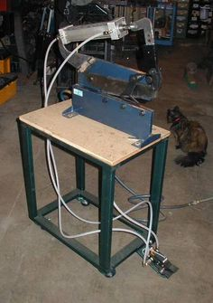 "Air Shear by Ernie Leimkuhler -- Homemade conversion of a 12"" hand shear to pneumatic. Features a 2.5"" air cylinder and operates at 100 psi. Cuts 1/8"" aluminum, 3/8"" round, and 18 ga steel. http://www.homemadetools.net/homemade-air-shear"