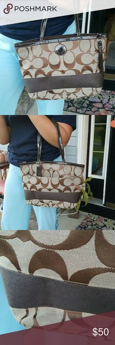 Coach signature stripe tote Beautiful classic tote has a small mark shown in pic. Zipper inside pocket and a pocket on the back side  shows some wear around bottom edge and a small spot on pure shown in pic. Coach Bags Shoulder Bags