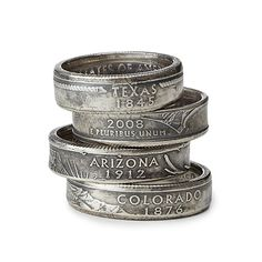 Commemorative state quarters are punched out and then re-worked into these richly detailed rings. The rings are then silver plated which gives them an added patina.  State name and statehood year are visible on the outer surface.