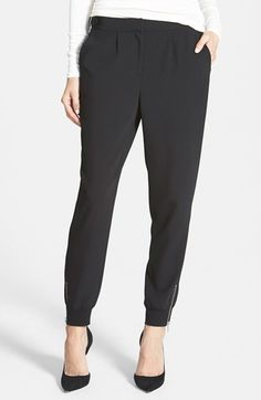 Free shipping and returns on Trouve Trouvé Zip Track Pants at Nordstrom.com. Smooth crepe shapes ultrachic track pants topped with a waistline belt fastener and finished with gleaming zip closures located above the rib-knit tapered cuffs.
