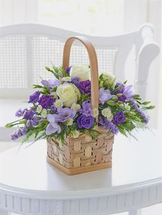 The pattern in this arrangement is white roses , purple roses and also the hyacinth flowers. Basket Flower Arrangements, Floral Arrangements, Easter Flowers, Spring Flowers, Ikebana, Silk Flowers, Beautiful Flowers, Hyacinth Flowers, Rose Flowers