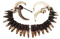 Philippines ~ Ifugao   Warrior's necklace from the Bontoc people of the Cagayan valley   Pieces of shell cut into the shape of animal teeth, fiber and two wild boar tusks.