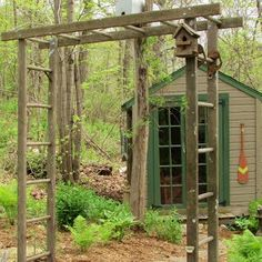 "A wonderful repurposed garden arbor on the approach to my ""She Shed"" made from my grandfather's old wooden extension ladder."