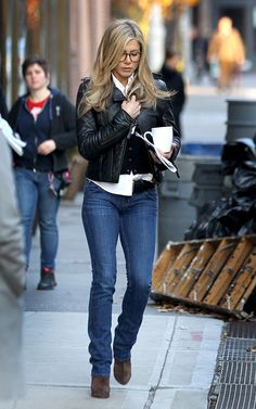 Jennifer Aniston Winter Outfit : Blue Jeans + Cardigan over Collared Shirt + Leather Jacket + Booties