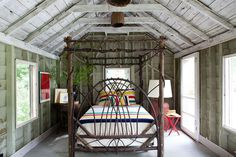 Coolest bed ever!! And I love the whitewashed timber ... and that giant lamp ... and all the light ...