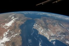 Oblique panorama showing almost the entire Iberian Peninsula (Spain and Portugal) at right, Morocco and other parts of Africa (left) and the Strait of Gibraltar (top center) on Aug. 23, 2014.