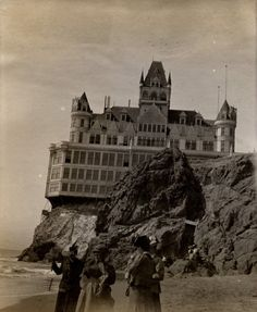 """Victorian Cliff House:  """"Cliff House has had five major incarnations since its beginnings in 1858. In 1896, Adolph Sutro built a new Cliff House, a seven story Victorian Chateau, called by some """"the Gingerbread Palace"""", below his estate on the bluffs of Sutro Heights. Great throngs of San Franciscans arrived on steam trains, bicycles, carts and horse wagons on Sunday excursions.    The House burned to the ground on the evening of September 7, 1907″"""