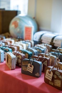 So cute!  Suitcase escort cards for travel-themed wedding.  When you pick them up, they open and inside the suitcase reveals the table number/name.