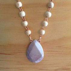 """Polished Wooden beadsHand made copper wire linksJasper Stone Pendant50"""" all the way aroundThis necklace is long enough to wrap around twice!This necklace was partially made by the women in India and refined here in the U.S.!Happy Valentine's Day"""