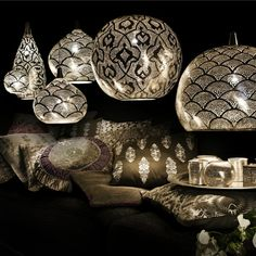 These are so beautiful, would go anywhere.  In my house at least! Punched metal pendant lights from Zenza.