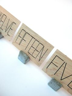 wood table markers.  with concrete stands. set by yournestinspired, $130.00 #yournestinspired