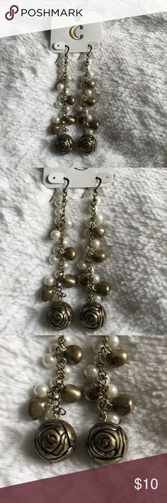 Stunning Pearl and Gold Plated Earrings These earrings are gorgeous! They feature a row of faux pearls and gold plated balls that lead to a gold plated rose design on the ends. Some gold plated areas are slightly discolored, but further enhances and beauty, charm, and uniqueness of the earrings! Length: 4 inches Jewelry Earrings