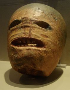 """This original """"Jack-o-lantern"""" made from a turnip in the early 19th century is on exhibit at the Museum of Country Life in Ireland. The making of jack-o'-lanterns, some sources maintain, springs theoretically from the custom of carving turnips into lanterns as a way of remembering the souls held in purgatory. Click for full size image."""