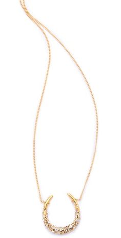 crystal encrusted horseshoe necklace by alexis bittar