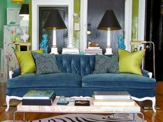 Beautiful peacock blue tufted couch and chartreuse pillows. by louisa