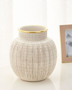 "Handcrafted vase. Ceramic with 18-kt. gold accents. 8.5""Dia. x 9""T. Made in Italy."