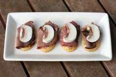 Top crackers with mustard, thin slices of roast beef and fresh mushroom slices for easy, but elegant appetizers.