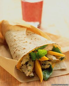 Chicken Wraps With Mango, Basil, and Mint  Garlic, shallot, basil, and cinnamon season the baked chicken breasts for these exotic wraps. Roll up the chicken in lavash bread with mango-shallot dressing, basil, mint, and fresh mango.  Get the Chicken Wraps With Mango, Basil, and Mint Recipe