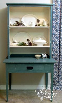 DIY:  >> A Hutch and Table Built From Random Parts. Top of a Book Shelf or an old Cupboard... Set and secure on top of a table to accommodate the size of Top you have chosen . Paint and Pretty it up , ( even pretty wallpaper in the back of Hutch part could be used ) . Then add items of choice to shelves. Click >>