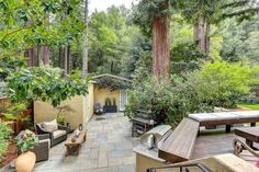 The backyard includes built-in benches and a bluestone patio.