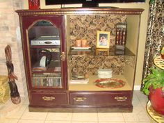 This is why I decided to learn to refinish furniture shabby chic style.  I wanted a new (old world) entertainment center that wouldn't cost 1800 dollars.  Bought this solid oak one for 50 bucks and refurbished it old world by my old self!  Shabby Chic, Distressed Furniture.