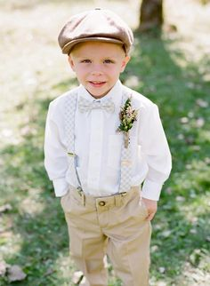 Adorable ring bearer. Loving the suspenders, bow tie and that cute little hat!