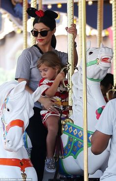 The race is on: North auntie Kourtney also got in on some carouseling action with daughter...