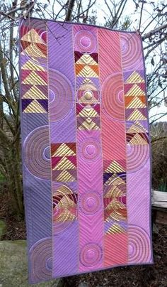 """Linzi Upton's """"In Pink"""". Love the movement that quilting gives. updated Flying Geese pattern in pinks and lavenders."""