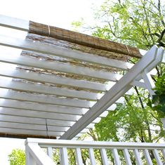 DIY Pergola Cover - We have a pergola over our deck, but needed more shade. I found an inexpensive reed fence at Home Depot that I attached to the top with zip ties. It offers the perfect amount of shade while still allowing a pretty pattern of filtered light. It is easy to take down for the winter or painting. I love it when I have an idea that actually works! =)