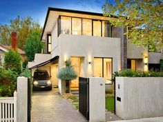 Concrete modern house exterior with balcony & hedging - House Facade photo 491424