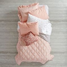 Add an instant touch of elegance to any kids' bedroom with our Modern Chic Bedding. This stunning bedding set features a quilt that's gathered and quilted for a truly delicate look. It even reverses to a gorgeous floral print. And the sheet set is made from super cozy 100% cotton percale.<br /><br /><NEWTAG/><ul><li>Nod exclusive</li><li>Quilt reverses to floral print and is quilted and gathered</li><li>Sheet set is 200-thread count cotton percale</li><li>Available in Twin, Full and…