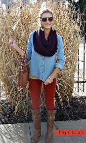 Chambray shirt with big bag, contrast infinity scarf, red leggins, brown tall boots, statement earrings and braclets