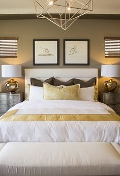 Master bedroom with bench, chandelier, and designer bedding