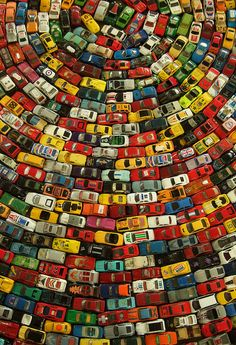 """Car Atlas by David T Waller  London-based artist David T Waller created Car Atlas – Rainbow, a beautiful art installation using nearly 2,500 toy cars arranged in a giant circular rainbow pattern. In 2010, it was displayed at Artsdepot's Apthorp Gallery and """"received the highest number of votes for people`s favourite artwork""""."""