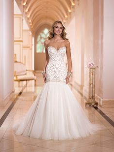 Gold beading and a shimmering flair make a show stopping and glamorous gown! Stella York available at Lilla's Bridal Pin from DreamWeddingsPA.com