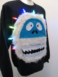 I would SO wear this! 😂 Light Up Ugly Christmas Sweater Bumble Abominable by MotherFrakers Diy Ugly Christmas Sweater, Ugly Xmas Sweater, Christmas Shirts, Christmas Fun, Holiday Fun, Xmas Sweaters, Ugly Sweaters Diy, Christmas Clothes, Christmas Jumpers