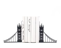 Unique metal bookends - London bridge - // decorative book holders // perfect housewarming gift // modern home decor // FREE SHIPPING by DesignAtelierArticle on Etsy https://www.etsy.com/ca/listing/205646667/unique-metal-bookends-london-bridge