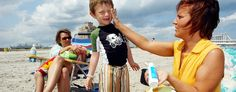 Bernadine Boyce, right, of Allentown, Pa., applies sunscreen to Bruno Barber, 5, of Atlantic City, as his mom, Natalia Barber, watches in Atlantic City, N.J. (Mary Godleski/AP)