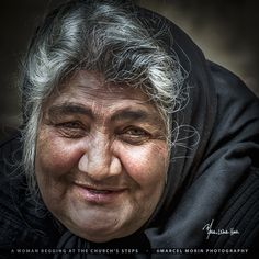 A woman begging at the church's steps by Marcel Morin on 500px