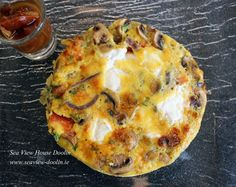 Here is one of our favourite breakfast's. Its made with mostly local ingredients and when we have our own tomatoes the dish averages less than 10 food miles.  Its a Frittata of our own eggs with caramelised onion's , mushrooms, tomatoes, herbs from our garden and St.Tola goats cheese. Served with our home made tomato chutney.