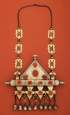 """A married woman's amulet container on chain (""""tumar""""). Central Asia: Turkoman people; early 20th c. Height, with chain as shown: 46 cm; width 22 cm. Silver-gilt with carnelians. Published in Truus Daalder, *Ethnic Jewellery and Adornment*, p. 360."""