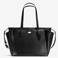 """NWT COACH  diaper bag,  black NWT COACH  diaper bag, black. Cross grain leather, zip top closure with fabric lining.  2 outside pockets.  Handles with 9 1/2"""" drop.  Adjustable strap for crossbody or shoulder wear.  Comes with changing pad.   17"""" (L) X 11 3/4"""" (H) X 7"""" (W) Coach Bags Shoulder Bags"""