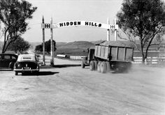 The front gate in the new development of Hidden Hills, circa 1950s. Truck with fill dirt entering the subdivision. Hidden Hills was founded by developer A. E. Hanson in the late 1950s. Calabasas Historical Society. San Fernando Valley History Digital Library.