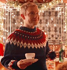 And he still manages to look cool in a hideous Christmas jumper...